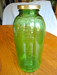 Click here to enlarge image and see more about item bottle40716: Depression Glass Juice Bottle