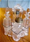 Click here to enlarge image and see more about item castor70527: Antique Cruet Set Belmont Zipper