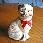 Click here to enlarge image and see more about item cat50611: Still Bank Antique Cat