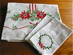 Click here to enlarge image and see more about item christmas10620: Vintage Holiday Tablecloth and Tea Towels
