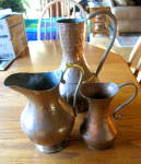 Click here to enlarge image and see more about item copperpitchers1115: Hammered Copper Pitchers