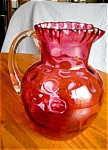 Click here to enlarge image and see more about item cranberry10601: Victorian Cranberry Glass Pitcher