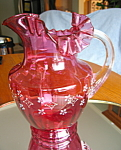 Click here to enlarge image and see more about item cranberry10722: Antique Enameled Cranberry Glass Pitcher