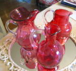 Click here to enlarge image and see more about item cranberrypitchers0915: Cranberry Glass Pitchers
