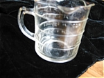 Vintage three Spout measuring jar. It has ounces and cups measurements. Likely a depression era jar. No chips or cracks and is 3.5 tall and 3 wide. It is showing some age/wear, especially around botto...