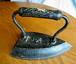 Click here to enlarge image and see more about item iron9308: Antique Tole Painted Sad Iron