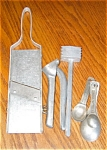 Click here to enlarge image and see more about item kstf04041: Vintage Cucumber Slicer, Garlic Press, etc.