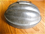 Click here to enlarge image and see more about item molds110530: Antique Kreamer Tin Melon Mold