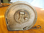 Click here to enlarge image and see more about item mtape60815: Antique Crogan Metal Tape Measure