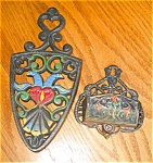 Click here to enlarge image and see more about item mtriv06061: Vintage Matchsafe and Trivet