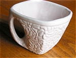 Click here to enlarge image and see more about item nil30403: Niloak Pottery Bouquet Dinnerware Cup