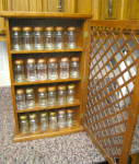 Click here to enlarge image and see more about item oakspice100310: Oak Spice Cabinet w/Jars