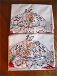 Click here to enlarge image and see more about item pillowcases90525: Vintage Embroidered Ladies and Birds Pillowcases