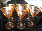 Click here to enlarge image and see more about item pinkglass110809: Vintage Etched Pink Glass Stemware