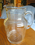 Click here to enlarge image and see more about item pitcher101408: Depression Glass Etched Pitcher