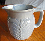 Click here to enlarge image and see more about item pitcher92508: Vintage Arc and Leaf Pitcher