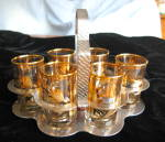Click here to enlarge image and see more about item shots110409: Vintage Bar Glass Set Gold Overlay