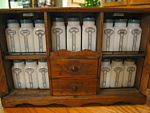 Click here to enlarge image and see more about item spice10206a: Vintage Griffith's Milk Glass Spice Jars w/Rack