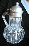 Click here to enlarge image and see more about item syrup112506a: Patented Antique Syrup Pitcher