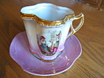 Click here to enlarge image and see more about item teacup110406: Vintage Porcelain Mug and Saucer