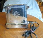 Click here to enlarge image and see more about item toaster030910: Patented Vintage Electric L. F. C. Toaster