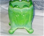 Click here to enlarge image and see more about item tpix12022: Boyd Glass Old Sleepy Eye Slag Toothpick
