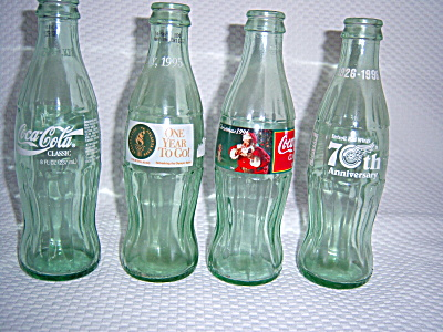 Lot FOUR Coca Cola COKE Bottles RED WINGS ~ SANTA ~  (Image1)