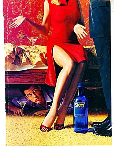 SKYY Vodka ad MAN HIDING UNDER TABLE (Image1)