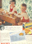 Click here to enlarge image and see more about item K042803E: 1948 Nucoa Margarine Twins WoodCradle Doll Ad