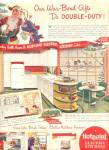 Click here to enlarge image and see more about item K759: 1941 Hot Point Electric Kitchen War Bonds Ad