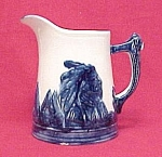 Click here to enlarge image and see more about item 16528: Old Sleepy Eye White & Cobalt 8 inch Blue Rim Pitcher