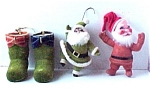 Click here to enlarge image and see more about item 311: Lot o 4 Flocked 1970s Christmas Ornaments Santa Boots
