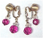 Click here to enlarge image and see more about item 356: Napier Goldtone Fuchsia Cut Crystal Dangle Clp Earrings