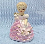 Click here to enlarge image and see more about item 44415: Little Girl Figurine in Pink Ruffles Marilyn Exclusive