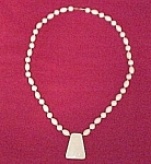 Click here to enlarge image and see more about item 544: Contemporary Ivory Plastic Bead & Pendant 30in Necklace