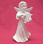 Click here to enlarge image and see more about item 55720: White Bisque Angel Figurine Playing a Harp Napco Japan