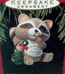 Click here to enlarge image and see more about item 58837: 1993 Hallmark Miniature Ornament Grandchilds First Christmas Racoon