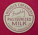 Click here to enlarge image and see more about item 606: Nichol's Creamery Dairy Milk Bottle Cap Advertising