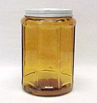 Click here to enlarge image and see more about item 68309: Amber Depression Era Glass Tobacco Jar Kitchen Canister