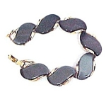 Click here to enlarge image and see more about item 69188: Lisner Chunky Grey Thermoset Lucite Goldtone Bracelet