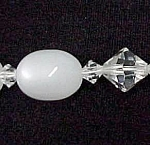 Click here to enlarge image and see more about item 74995: Lucite Moonstone Aurora Borealis AB Crystal Necklace