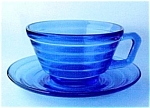 Click here to enlarge image and see more about item 75017: Moderntone Cobalt Cup and Saucer HA Depression Glass