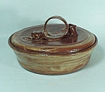 Click here to enlarge image and see more about item 78268: Studio Art Pottery Cov Casserole Ribbon Hndl House Logo