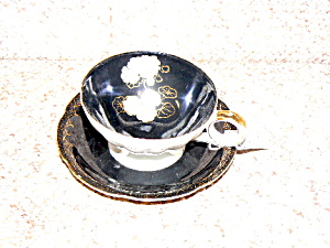 Black And White Flowered 3 Legged Cup &saucer