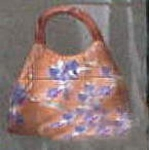 Click here to enlarge image and see more about item 0050: Purse Orange Brown Cookie Jar