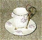 Click here to enlarge image and see more about item 3x20leggedx20teax20cup: 3 three Legged roses on white tea cup