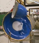 Click here to enlarge image and see more about item bluecup: Blue 4 legs cup and saucer