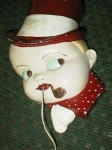 Click here to enlarge image and see more about item boystringholder: Old Chalkware Boy with Pipe Stringholder