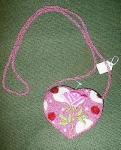 Click here to enlarge image and see more about item heartpurse: Heart Shaped Vintage like Beaded Purse