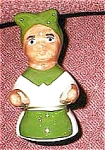 Click here to enlarge image and see more about item mammypiebird: Black Mammy in green apron pie bird